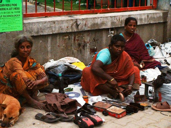 Cobbler Puttalayamma (centre) with other footpath vendors